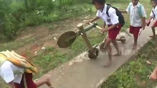 Indonesian kids make bicycles out of wood and bamboo