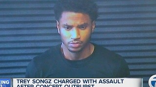 Singer Trey Songz charged with assault after concert outburst - Video
