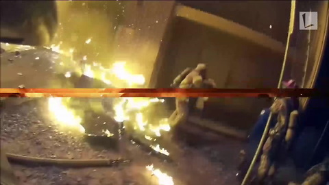 Fire Dept. Releases Dramatic Video of Toddler Dropped from Window of Burning Building