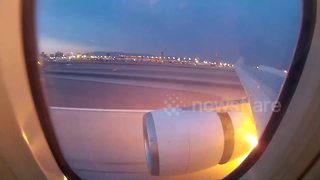 Stalled airplane engine catches fire at Las Vegas airport - Video