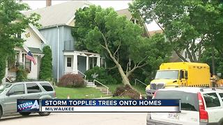 Overnight storms uproot trees in Milwaukee's Riverwest neighborhood leaving damage to homes, cars - Video