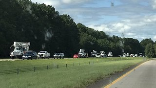 Chain of Power Line Trucks Battles I-95 Southbound Traffic in South Carolina - Video