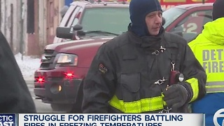 Firefighters struggle to fight fires in freezing temperatures - Video