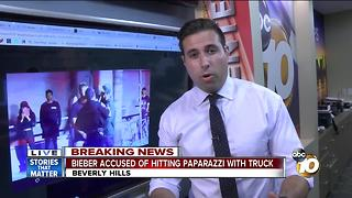 Bieber accused of hitting paparazzo with truck ++ - Video