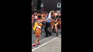 Dancing police officer takes a twirl at the Notting Hill Carnival