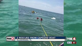Coast Guard rescues two from capsized boat - Video