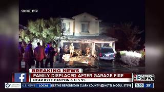 Family displaced after vehicles catch fire - Video