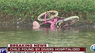 Child pulled from water in suburban West Palm Beach - Video