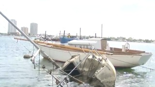 Organization works to remove sunken boats - Video