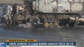 Crews working to clear burned Amazon truck on I-15 - Video