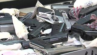 Cleveland police show off dozens of guns taken off of streets - Video