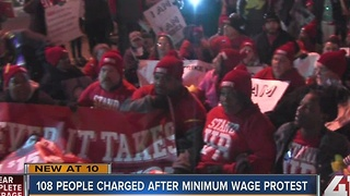 108 people charged after minimum wage protest - Video