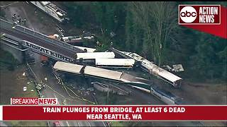 Amtrak train plunges from bridge near Seattle, at least 6 dead - Video