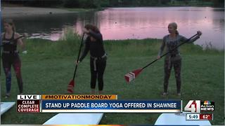 Stand up paddleboard yoga offered in Shawnee