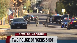 Polices officers in hospital after getting shot