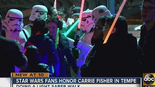 Fans gather to remember Carrie Fisher with light saber walk - Video