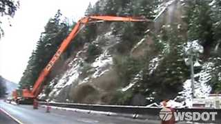 WSDOT Crews Remove Unstable Boulder From Hillside Next to Highway - Video