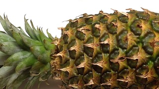 How to peel and cut a pineapple in one minute - Video
