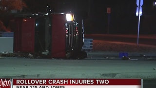 Two fighting for their lives after rollover crash - Video