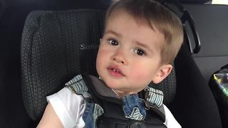 Toddler attempts to whistle, hilariously fails - Video