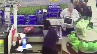 VIDEO: Elderly woman swipes wallet at checkout - Video