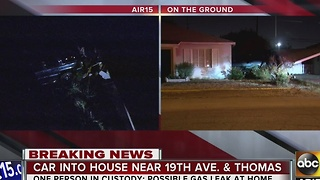 Car into house in Phoenix after driver crashes - Video