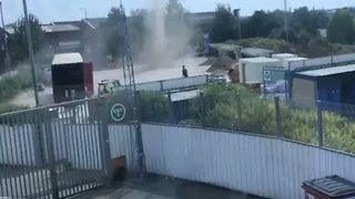 Dust Tornado Twists Past Cars at Birmingham City Football Stadium - Video