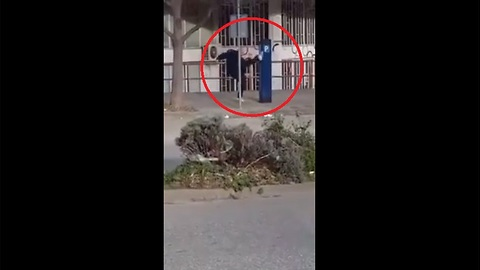 Man fights with a parking machine (for reasons unknown)