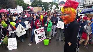 Demonstrators Hurl Water-Filled Condoms at Trump Effigy Amid Protest During Tillerson Visit - Video