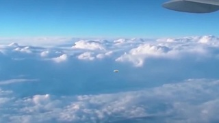 UFO filmed from airplane over Russia  - Video