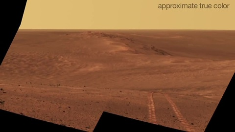 Mars rover looks back at tracks on crater rim