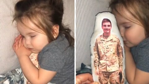 Toddler preciously cuddles pillow of her deployed military father