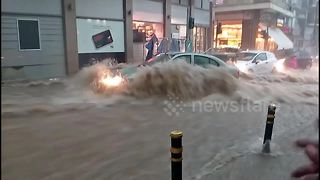 Drivers stranded in flash floods as severe storm hits northern Greece