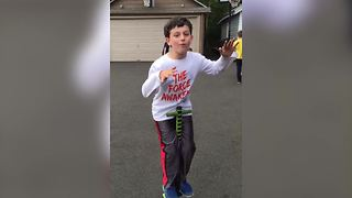 A Little Boy Fails At Jumping On A Pogo Stick Hands-Free