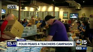 Four Peaks Brewery building boxes of supplies for classrooms - Video