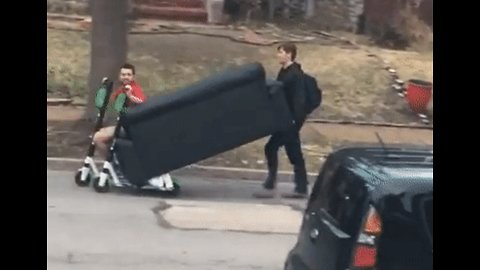 St Louis College Friends Use Rental Scooters to Move Couch