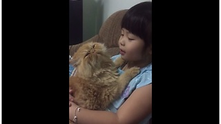 Little Girl Preciously Sings To Her Defiant Kitty Cat - Video