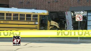 School bus driver runs light, crashes into building - Video