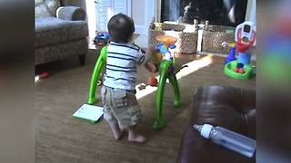 Baby Boy Learns How To Walk With A Baby Walker Toy