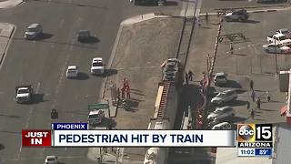 Man hospitalized after being struck by train in Phoenix - Video