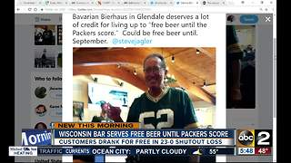 Bar serves free beer until Packers score - Video