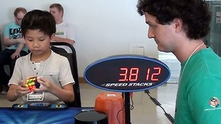 Child Prodigy Takes 8.72 Seconds to Solve Rubik's Cube - Video