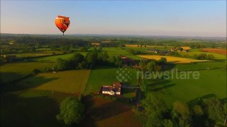 Drone camera captures hot air balloons at sunset - Video