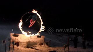 Skier does switch backflip through flames - Video