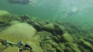 GoPro cam swept away in river captures beautiful footage - Video
