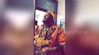 Moviegoers attend Black Panther Premier in traditional African clothing - Video