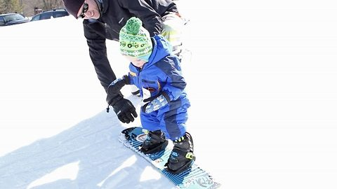 Tiny Toddler Learns To Snowboard Just Two Months After He Started Walking