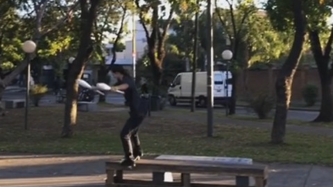 Talented Skateboarder Juggles Pins While Performing Trick