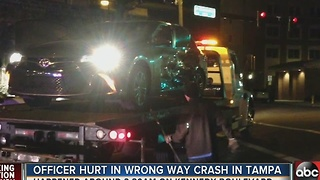 Officer hurt in wrong way crash in Tampa - Video