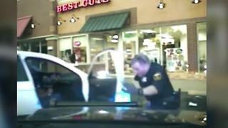 Euclid officer knocked to the ground during traffic stop when car speeds off - Video